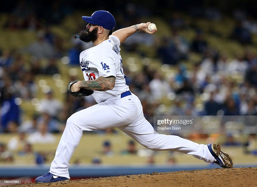 Relief pitcher Brian Wilson #00 of the Los Angeles Dodgers throws a pitch in the tenth inning against the San Francisco Giants at Dodger Stadium on September 12, 2013 in Los Angeles, California. The Dodgers won 3-2 in ten innings.