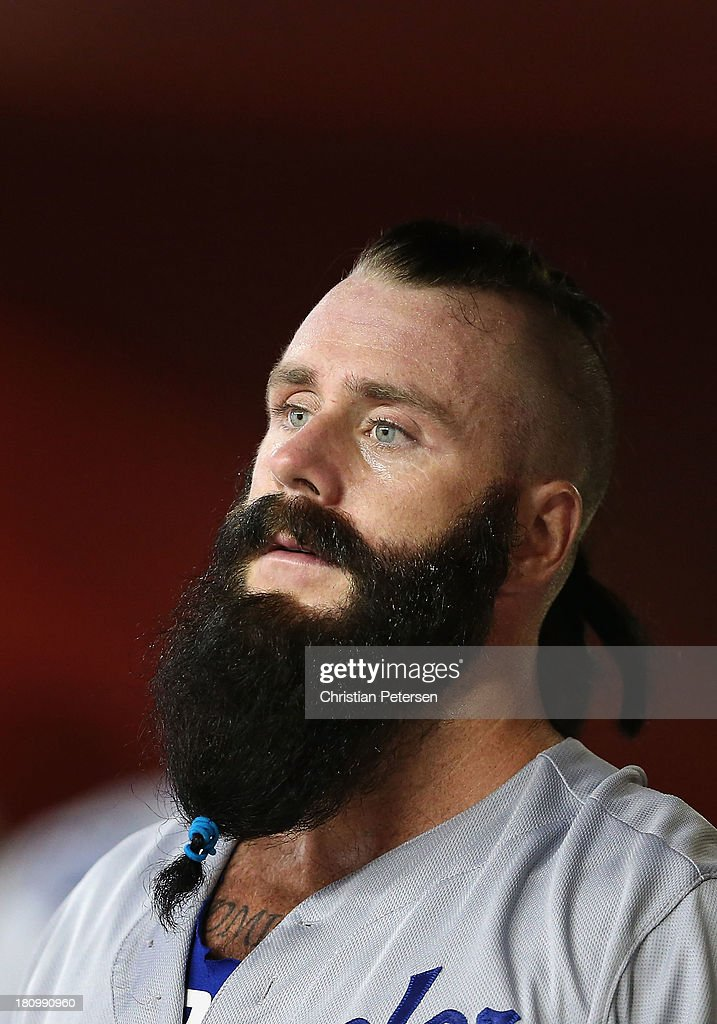 Relief pitcher Brian Wilson #00 of the Los Angeles Dodgers watches from the dugout during the MLB game against the Arizona Diamondbacks at Chase Field on September 18, 2013 in Phoenix, Arizona.