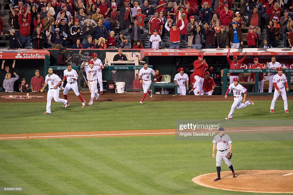 Relief pitcher <a gi-track='captionPersonalityLinkClicked' href=/galleries/search?phrase=Bryan+Shaw+-+Baseball+Player&family=editorial&specificpeople=11376278 ng-click='$event.stopPropagation()'>Bryan Shaw</a> #27 of the Cleveland Indians reacts and the Los Angeles Angels of Anaheim bench clears as <a gi-track='captionPersonalityLinkClicked' href=/galleries/search?phrase=Brendan+Ryan&family=editorial&specificpeople=835643 ng-click='$event.stopPropagation()'>Brendan Ryan</a> #23 of the Los Angeles Angels of Anaheim runs while scoring on a walk-off RBI single by <a gi-track='captionPersonalityLinkClicked' href=/galleries/search?phrase=Yunel+Escobar&family=editorial&specificpeople=757358 ng-click='$event.stopPropagation()'>Yunel Escobar</a> during the ninth inning of the game at Angel Stadium of Anaheim on June 11, 2016 in Anaheim, California.