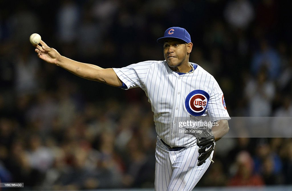 Relief pitcher <a gi-track='captionPersonalityLinkClicked' href=/galleries/search?phrase=Carlos+Marmol&family=editorial&specificpeople=556707 ng-click='$event.stopPropagation()'>Carlos Marmol</a> #49 of the Chicago Cubs throws to third base to catch Yadier Molina #4 of the St. Louis Cardinals stealing during the eighth inning on May 7, 2013 at Wrigley Field in Chicago, Illinois.