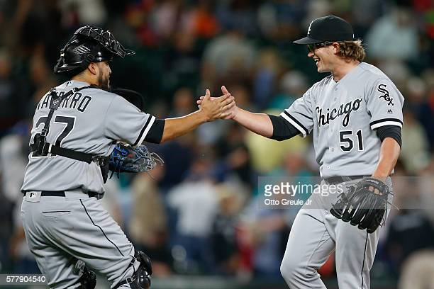 Relief pitcher Carson Fulmer of the Chicago White Sox is congratulated by catcher Dioner Navarro after defeating the Seattle Mariners 61 at Safeco...