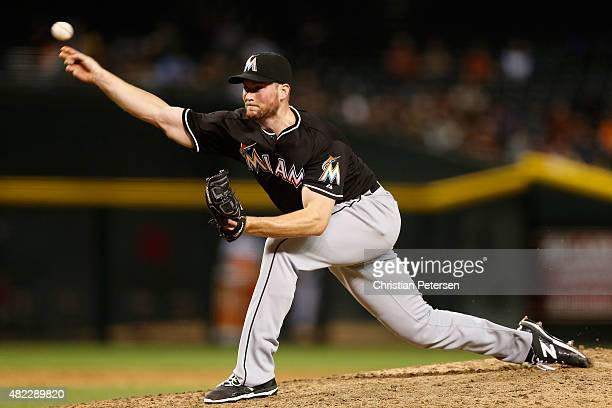 Relief pitcher Carter Capps of the Miami Marlins pitches against the Arizona Diamondbacks during the MLB game at Chase Field on July 21 2015 in...