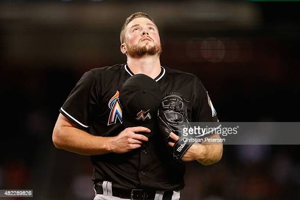 Relief pitcher Carter Capps of the Miami Marlins reacts after pitching against the Arizona Diamondbacks during the MLB game at Chase Field on July 21...