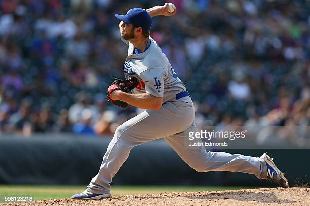 Relief pitcher Casey Fien of the Los Angeles Dodgers delivers to home plate during the seventh inning against the Colorado Rockies at Coors Field on...