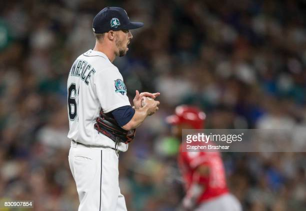 Relief pitcher Casey Lawrence of the Seattle Mariners reacts after giving up a tworun home run to Luis Valbuena of the Los Angeles Angels of Anaheim...