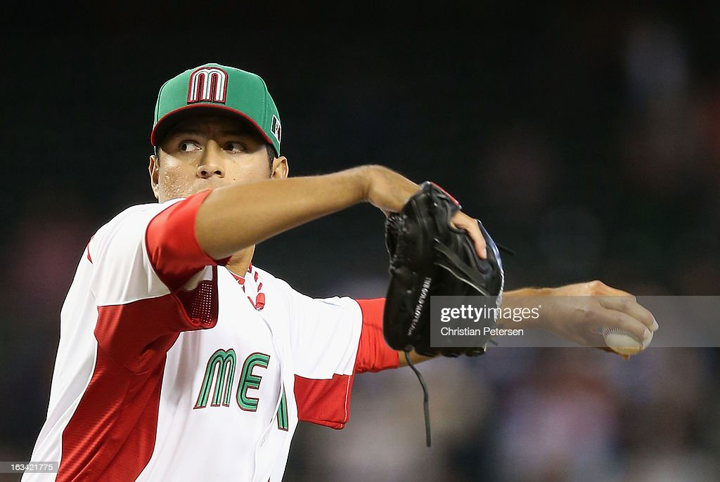 Relief pitcher Cesar Ramos #27 of Mexico pitches against Canada during the World Baseball Classic First Round Group D game at Chase Field on March 9, 2013 in Phoenix, Arizona.