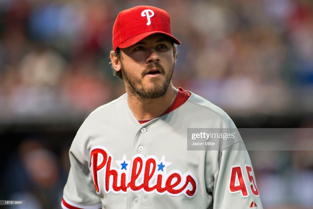 Relief pitcher <a gi-track='captionPersonalityLinkClicked' href=/galleries/search?phrase=Chad+Durbin&family=editorial&specificpeople=834332 ng-click='$event.stopPropagation()'>Chad Durbin</a> #45 of the Philadelphia Phillies walks to the dugout after giving up four runs during the fifth inning against the Cleveland Indians at Progressive Field on April 30, 2013 in Cleveland, Ohio.