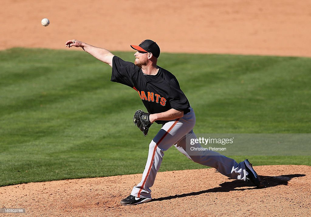Relief pitcher <a gi-track='captionPersonalityLinkClicked' href=/galleries/search?phrase=Chad+Gaudin&family=editorial&specificpeople=3011132 ng-click='$event.stopPropagation()'>Chad Gaudin</a> #53 of the San Francisco Giants pitches against the Los Angeles Angels during the spring training game at Tempe Diablo Stadium on February 27, 2013 in Tempe, Arizona.
