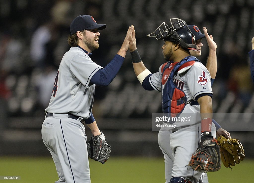 Relief pitcher Chris Perez #54 high-fives catcher Carlos Santana #41 of the Cleveland Indians after their win over the Chicago White Sox on April 22, 2012 at U.S. Cellular Field in Chicago, Illinois. The Indians defeated the White Sox 3-2.