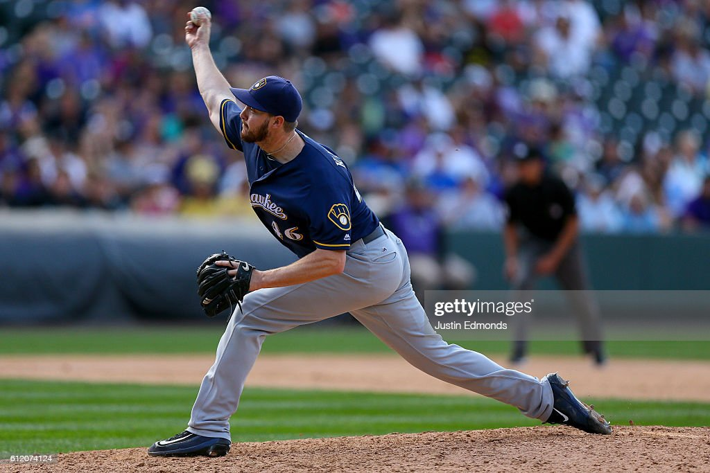 Relief pitcher Corey Knebel #46 of the Milwaukee Brewers delivers to home plate during the tenth inning against the Colorado Rockies at Coors Field on October 2, 2016 in Denver, Colorado. The Brewers defeated the Rockies 6-4. The Rockies finished their season 75-87.