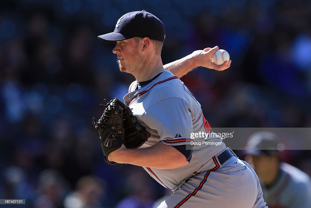 Relief pitcher <a gi-track='captionPersonalityLinkClicked' href=/galleries/search?phrase=Craig+Kimbrel&family=editorial&specificpeople=6795784 ng-click='$event.stopPropagation()'>Craig Kimbrel</a> #46 of the Atlanta Braves collects a blow slave as he delivers against the Colorado Rockies in the ninth inning at Coors Field on April 24, 2013 in Denver, Colorado. The Rockies defeated the Braves 6-5 in 12 innings.