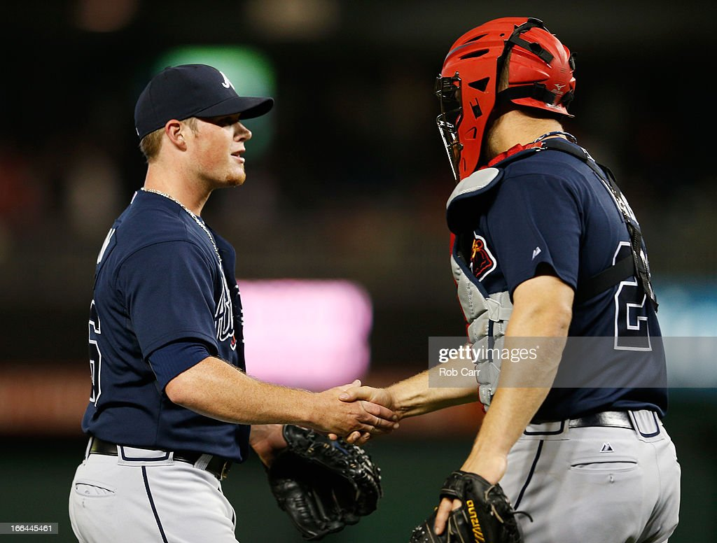 Relief pitcher <a gi-track='captionPersonalityLinkClicked' href=/galleries/search?phrase=Craig+Kimbrel&family=editorial&specificpeople=6795784 ng-click='$event.stopPropagation()'>Craig Kimbrel</a> #46 of the Atlanta Braves is congratulated by catcher Evan Gattis #24 after the Braves defeated the Washington Nationals 6-4 in extra innings at Nationals Park on April 12, 2013 in Washington, DC.