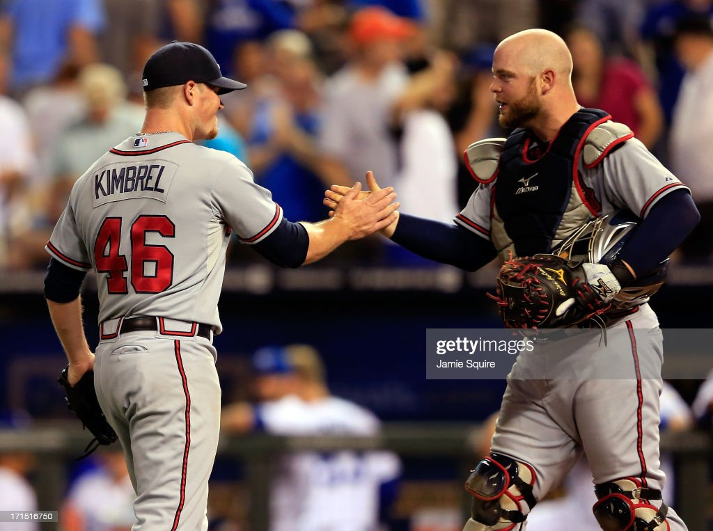Relief pitcher <a gi-track='captionPersonalityLinkClicked' href=/galleries/search?phrase=Craig+Kimbrel&family=editorial&specificpeople=6795784 ng-click='$event.stopPropagation()'>Craig Kimbrel</a> #46 of the Atlanta Braves is congratulated by catcher <a gi-track='captionPersonalityLinkClicked' href=/galleries/search?phrase=Brian+McCann+-+Baseball+Player&family=editorial&specificpeople=593065 ng-click='$event.stopPropagation()'>Brian McCann</a> #16 after the Braves defeated the Kansas City Royals 4-3 to win the game at Kauffman Stadium on June 25, 2013 in Kansas City, Missouri.