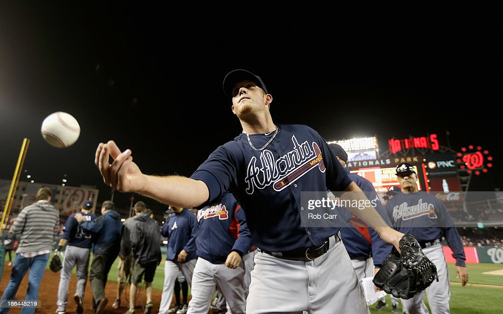 Relief pitcher <a gi-track='captionPersonalityLinkClicked' href=/galleries/search?phrase=Craig+Kimbrel&family=editorial&specificpeople=6795784 ng-click='$event.stopPropagation()'>Craig Kimbrel</a> #46 of the Atlanta Braves throws a ball into the crowd after the Braves defeated the Washington Nationals 6-4 in extra innings at Nationals Park on April 12, 2013 in Washington, DC.