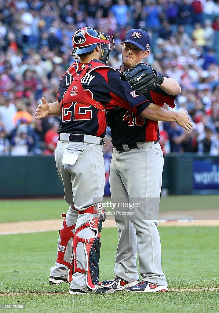Relief pitcher Craig Kimbrel #46 of USA celebrates with catcher Jonathan Lucroy #22 after defeating Canada 9-4 in the World Baseball Classic First Round Group D game at Chase Field on March 10, 2013 in Phoenix, Arizona.
