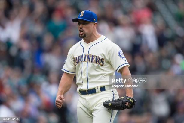 Relief pitcher Dan Altavilla of the Seattle Mariners reacts as he walks off the field after the final out of the top half of eighth inning of a game...