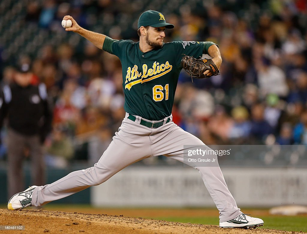 Relief pitcher Dan Otero #61 of the Oakland Athletics pitches against the Seattle Mariners in the seventh inning at Safeco Field on September 29, 2013 in Seattle, Washington. The Athletics defeated the Mariners 9-0.