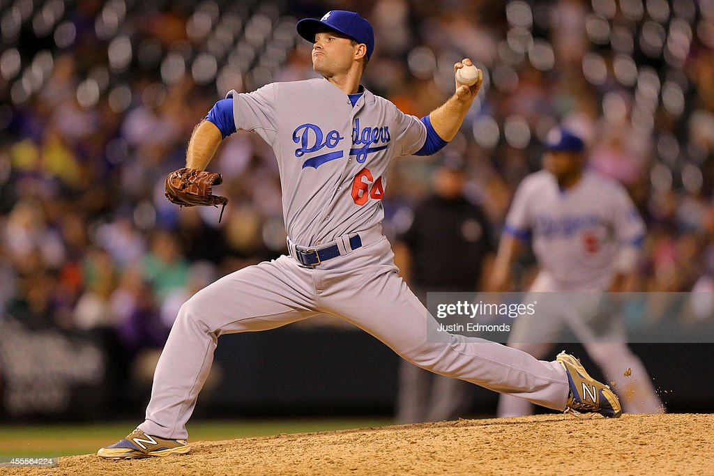 Relief pitcher Daniel Coulombe #64 of the Los Angeles Dodgers delivers to home plate during the seventh inning against the Colorado Rockies at Coors Field on September 16, 2014 in Denver, Colorado.
