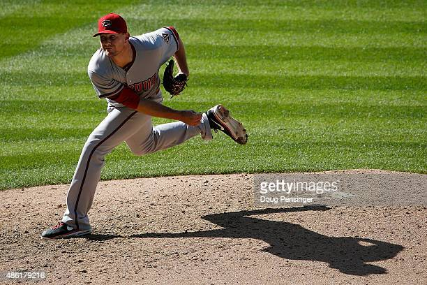 Relief pitcher Daniel Hudson of the Arizona Diamondbacks delivers against the Colorado Rockies at Coors Field on September 1 2015 in Denver Colorado...