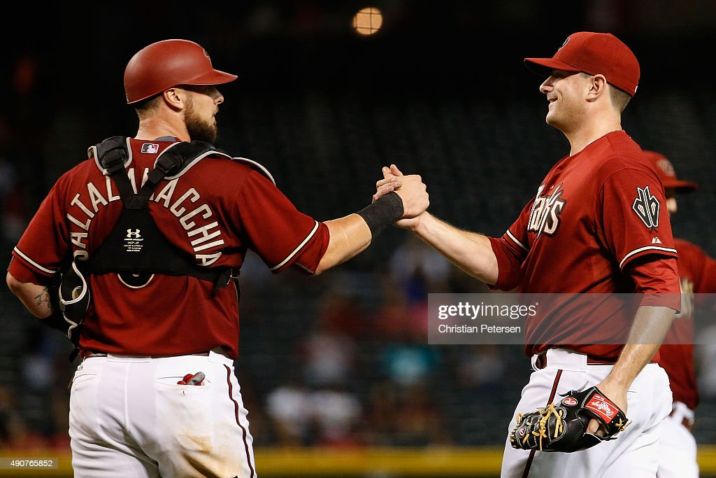 Relief pitcher Daniel Hudson #41 of the Arizona Diamondbacks high-fives Jarrod Saltalamacchia #8 after defeating the Colorado Rockies 3-1 in the MLB game at Chase Field on September 30, 2015 in Phoenix, Arizona.
