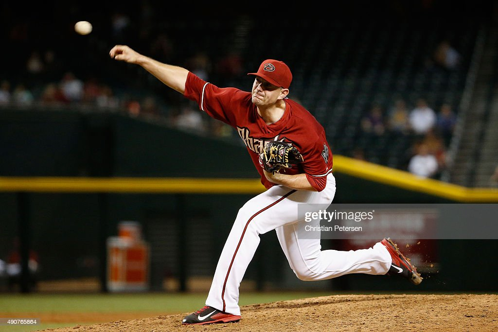 Relief pitcher Daniel Hudson #41 of the Arizona Diamondbacks pitches against the Colorado Rockies during the ninth inning of the MLB game at Chase Field on September 30, 2015 in Phoenix, Arizona. The Diamondbacks defeated the Rockies 3-1.