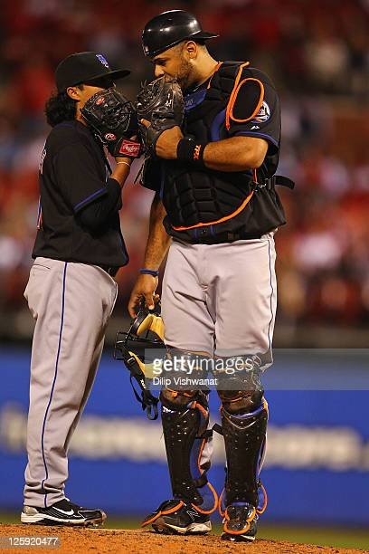 Relief pitcher Danny Herrera and catcher Ronny Paulino of the New York Mets meet on the pitcher's mound against the St Louis Cardinals at Busch...