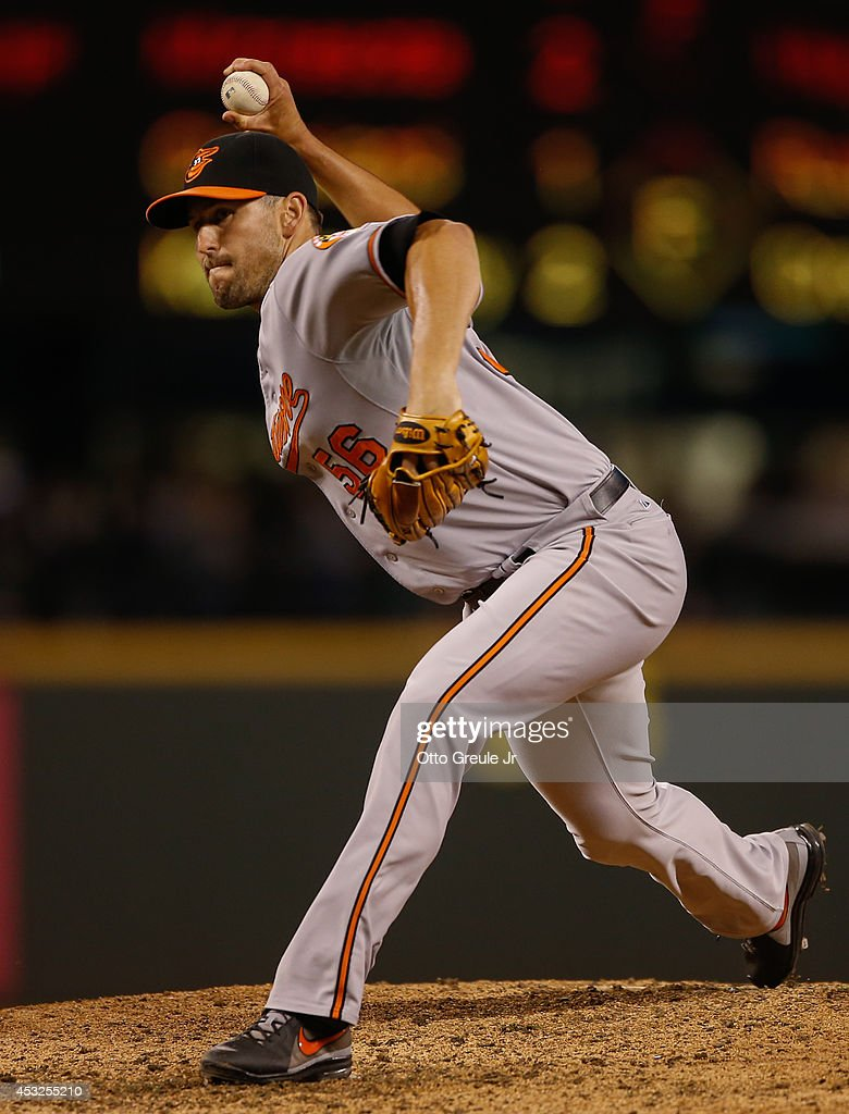 Relief pitcher Darren O'Day of the Baltimore Orioles pitches against the Seattle Mariners at Safeco Field on July 24 2014 in Seattle Washington