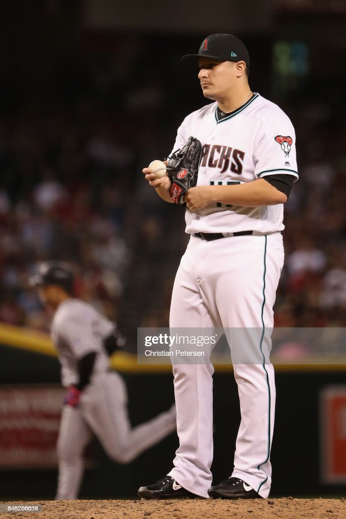 Relief pitcher David Hernandez #47 of the Arizona Diamondbacks reacts after giving up a two run home run to Carlos Gonzalez #5 of the Colorado Rockies during the seventh inning of the MLB game at Chase Field on September 12, 2017 in Phoenix, Arizona.