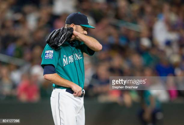 Relief pitcher David Phelps of the Seattle Mariners reacts after giving up an RBIsingle to Neil Walker of the New York Mets that scored Asdrubal...