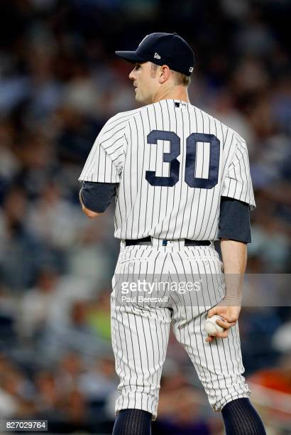 Relief pitcher David Robertson of the New York Yankees pitches in an MLB baseball game against the Detroit Tigers on August 1 2017 at Yankee Stadium...