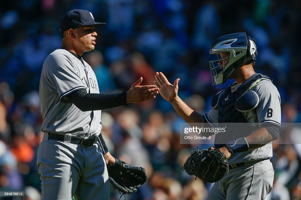 Relief pitcher Dellin Betances of the New York Yankees is congratulated by catcher Gary Sanchez after defeating the Seattle Mariners 40 at Safeco...
