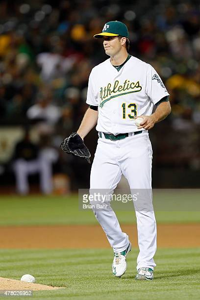 Relief pitcher Drew Pomeranz of the Oakland Athletics reacts after giving up a run on a walk with the bases loaded against the Los Angeles Angels of...