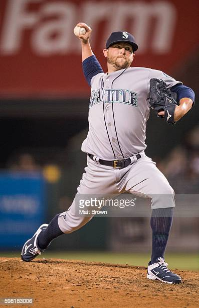 Relief pitcher Drew Storen of the Seattle Mariners pitches during the sixth inning of the game against the Los Angeles Angels of Anaheim at Angel...