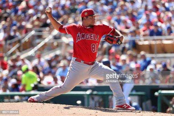 Relief pitcher Eduardo Paredes of the Los Angeles Angels pitches against the Los Angeles Dodgers during the third inning of the MLB spring training...