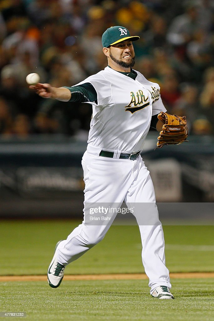 Relief pitcher Edward Mujica of the Oakland Athletics throws to first on a bunt single for Erick Aybar of the Los Angeles Angels of Anaheim in the...
