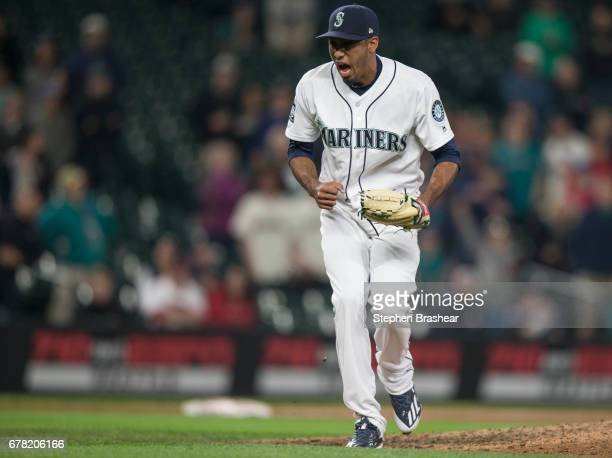Relief pitcher Edwin Diaz of the Seattle Mariners reacts after striking out Albert Pujols of the Los Angeles Angels of Anaheim to end the game at...