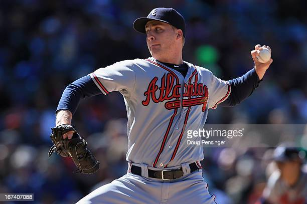 Relief pitcher Eric O'Flaherty of the Atlanta Braves delvers against the Colorado Rockies at Coors Field on April 24 2013 in Denver Colorado The...