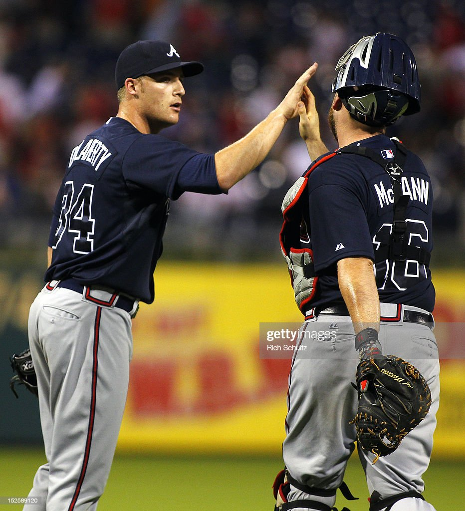 Relief pitcher <a gi-track='captionPersonalityLinkClicked' href=/galleries/search?phrase=Eric+O%27Flaherty&family=editorial&specificpeople=2191782 ng-click='$event.stopPropagation()'>Eric O'Flaherty</a> #34 of the Atlanta Braves is congratulated by teammate <a gi-track='captionPersonalityLinkClicked' href=/galleries/search?phrase=Brian+McCann+-+Baseball+Player&family=editorial&specificpeople=593065 ng-click='$event.stopPropagation()'>Brian McCann</a> #16 after the Braves defeated the Philadelphia Phillies 8-2 in a MLB baseball game on September 22, 2012 at Citizens Bank Park in Philadelphia, Pennsylvania.