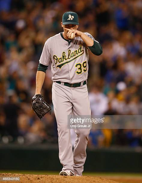Relief pitcher Eric O'Flaherty of the Oakland Athletics pauses on the mound after giving up a home run to Kendrys Morales of the Seattle Mariners in...