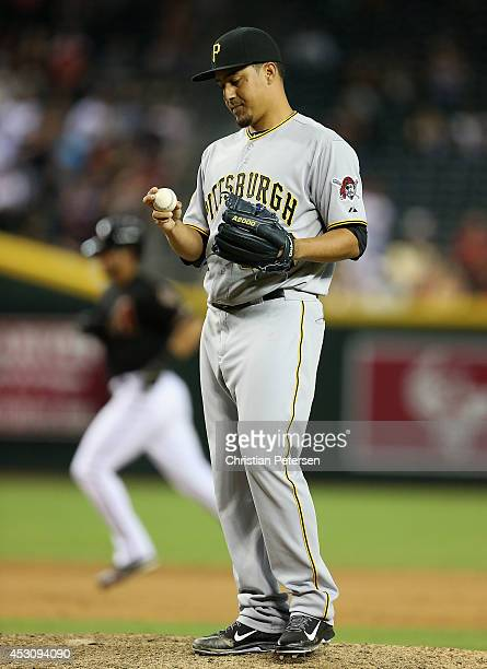 Relief pitcher Ernesto Frieri of the Pittsburgh Pirates reacts after giving up a tworun home run against David Peralta of the Arizona Diamondbacks...