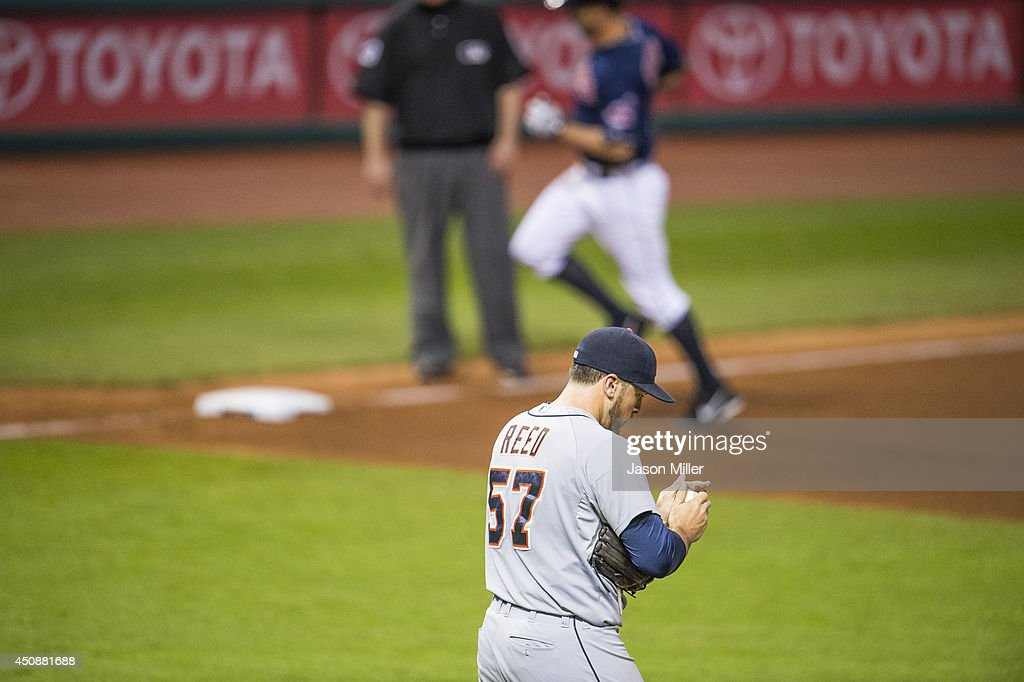 Relief pitcher Evan Reed #57 of the Detroit Tigers reacts after giving up a home run to David Murphy #7 of the Cleveland Indians during the seventh inning at Progressive Field on May 20, 2014 in Cleveland, Ohio.