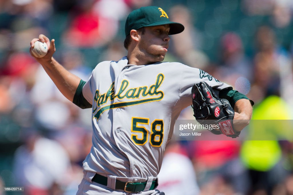 Relief pitcher Evan Scribner #58 of the Oakland Athletics pitches during the seventh inning against the Cleveland Indians at Progressive Field on May 9, 2013 in Cleveland, Ohio. The Indians defeated the Athletics 9-2.