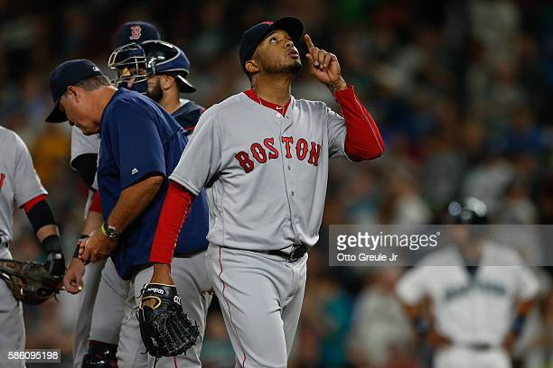 Relief pitcher Fernando Abad of the Boston Red Sox gestures after being removed in the ninth inning against the Seattle Mariners at Safeco Field on...