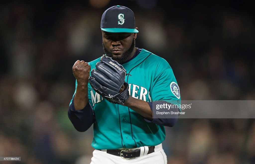Relief Pitcher <a gi-track='captionPersonalityLinkClicked' href=/galleries/search?phrase=Fernando+Rodney&family=editorial&specificpeople=547291 ng-click='$event.stopPropagation()'>Fernando Rodney</a> #56 of the Seattle Mariners reacts to getting the final out of the ninth inning of a game against the Oakland Athletics at Safeco Field on May 8, 2015 in Seattle, Washington.