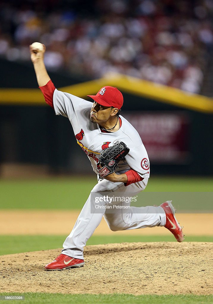 Relief pitcher <a gi-track='captionPersonalityLinkClicked' href=/galleries/search?phrase=Fernando+Salas&family=editorial&specificpeople=3016070 ng-click='$event.stopPropagation()'>Fernando Salas</a> #59 of the St. Louis Cardinals pitches against the Arizona Diamondbacks during the MLB Opening Day game at Chase Field on April 1, 2013 in Phoenix, Arizona. The Diamondbacks defeated the Cardinals 6-2.