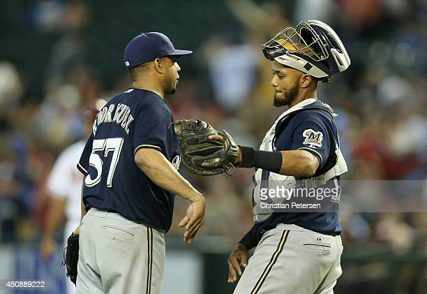 Relief pitcher Francisco Rodriguez and catcher Martin Maldonado of the Milwaukee Brewers celebrate after defeating the Arizona Diamondbacks 41 in the...