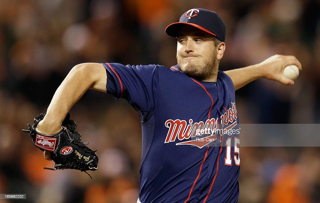 Relief pitcher <a gi-track='captionPersonalityLinkClicked' href=/galleries/search?phrase=Glen+Perkins&family=editorial&specificpeople=835845 ng-click='$event.stopPropagation()'>Glen Perkins</a> #15 of the Minnesota Twins throws to a Baltimore Orioles batter during the ninth inning of the Twins 6-5 win at Oriole Park at Camden Yards on April 6, 2013 in Baltimore, Maryland.