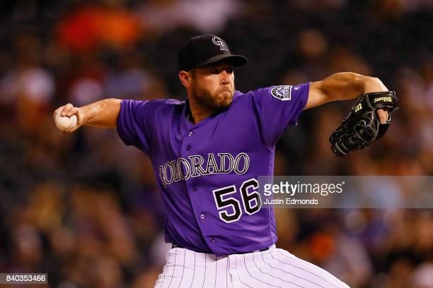 Relief pitcher Greg Holland of the Colorado Rockies delivers to home plate against the Detroit Tigers during the ninth inning of an interleague game...