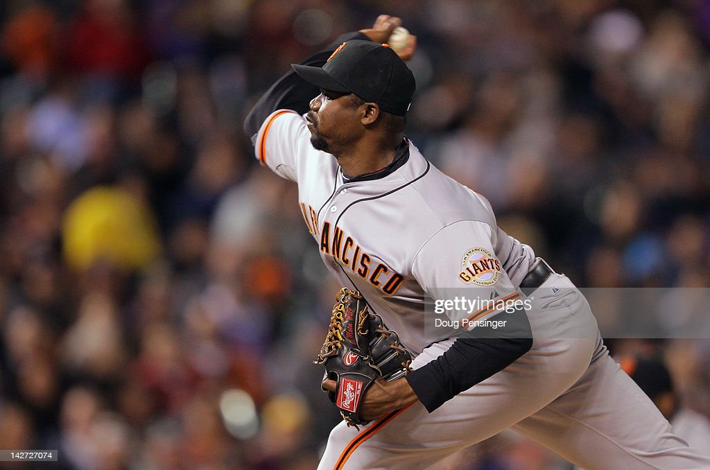 Relief pitcher <a gi-track='captionPersonalityLinkClicked' href=/galleries/search?phrase=Guillermo+Mota&family=editorial&specificpeople=208080 ng-click='$event.stopPropagation()'>Guillermo Mota</a> #59 of the San Francisco Giants delivers against the Colorado Rockies at Coors Field on April 11, 2012 in Denver, Colorado.