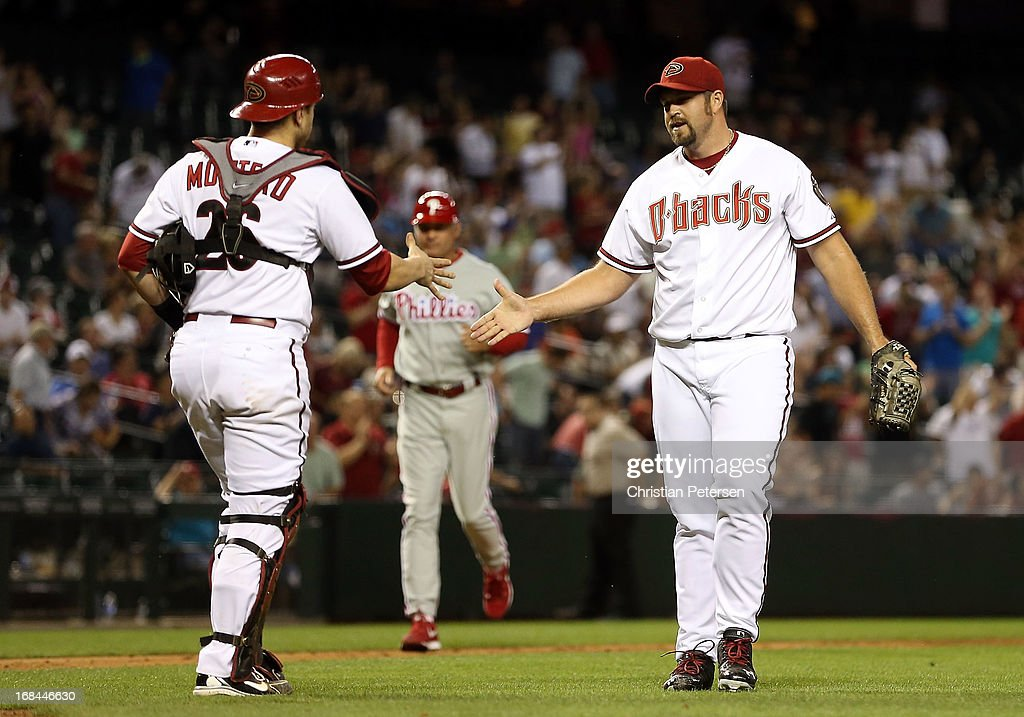 Relief pitcher <a gi-track='captionPersonalityLinkClicked' href=/galleries/search?phrase=Heath+Bell&family=editorial&specificpeople=243211 ng-click='$event.stopPropagation()'>Heath Bell</a> #21 of the Arizona Diamondbacks high-fives catcher <a gi-track='captionPersonalityLinkClicked' href=/galleries/search?phrase=Miguel+Montero&family=editorial&specificpeople=836495 ng-click='$event.stopPropagation()'>Miguel Montero</a> #26 after defeating the Philadelphia Phillies in the MLB game at Chase Field on May 9, 2013 in Phoenix, Arizona. The Diamondbacks defeated the Phillies 2-1.